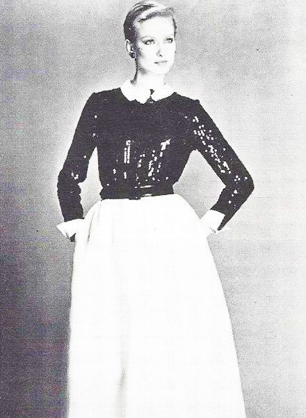The Adolfo evening look in 1983 showed American dressing at its best: a demure collar and cuffs with a shiny palette-embroidered top, combined with a full length skirt.