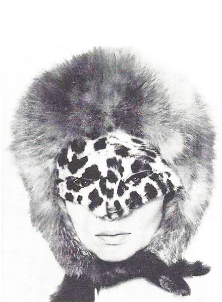 Adolfo created the cat-woman look in his 1964 collection. A leopard-skin mask and a red fox helmet made an arresting statement for winter sidewalks.